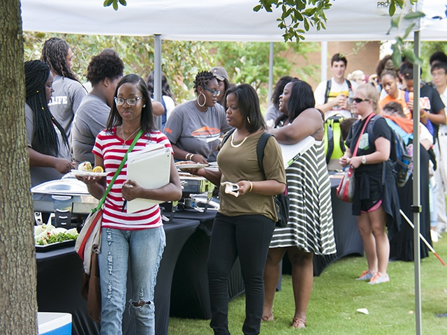 Students serving their plates on the quad