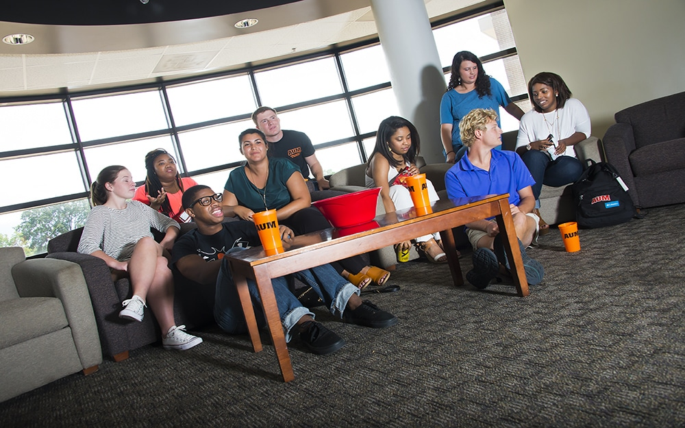 Students watching a movie in a residence hall