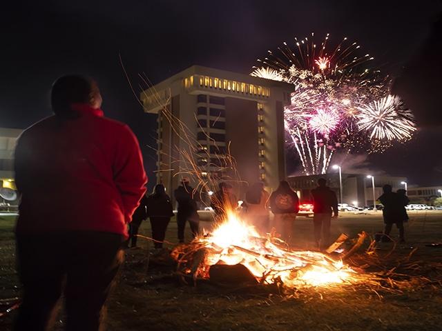 Students outside Homecoming bonfire